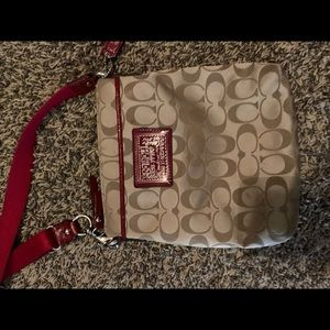 Coach imprinted red and tan crossbody purse